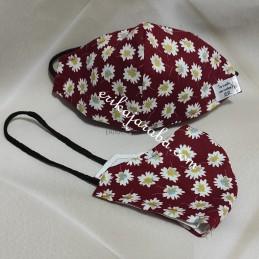 Mascarilla (HIDROFUGA-ANTIBACTERIA) niño  margaritas fondo granate  con gomas en la cabeza