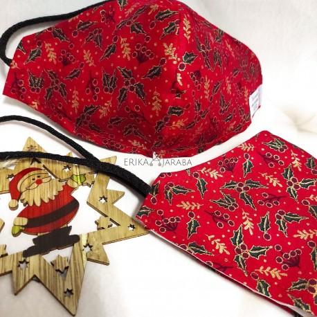 Mascarilla (HIDROFUGA-ANTIBACTERIA) niño Hojas de navidad fondo rojo con gomas en la cabeza